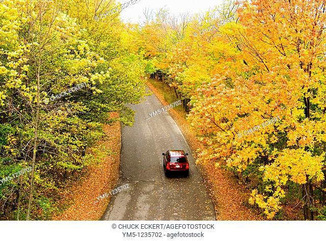 Car driving through Peninsula State Park, Door County, Wisconsin, USA during the autumn peak season