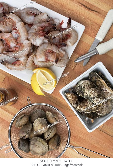 Raw Shrimp, Clams and Oysters with Lemons, High Angle View