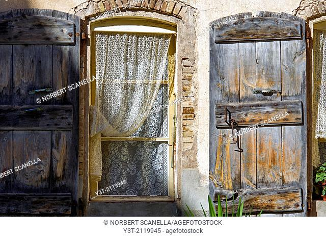 Europe, France, Var, Cotignac. Detail of an old house. Old shutters