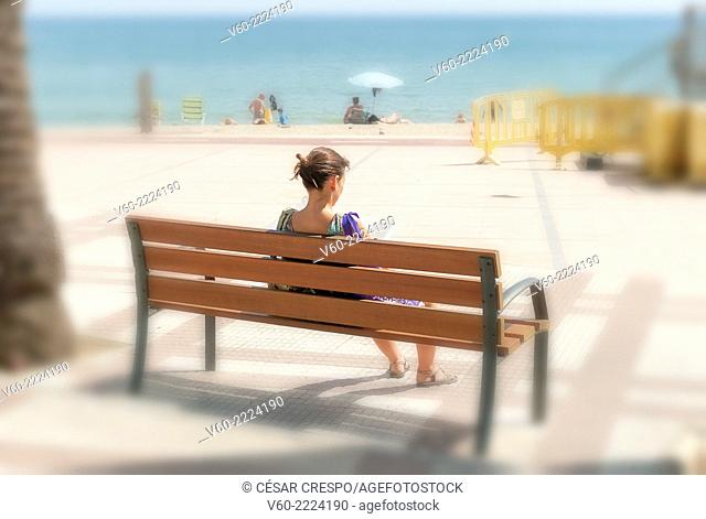 -Woman Reading a Book in front of beach- Cambrils Tarragona. Spain