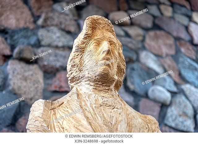 Close shot highlighting the details of the wooden statue of Polish Composer and pianist Fryderyk Chopin at the Fryderyk Chopin Museum