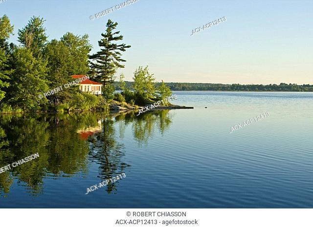 Cottage overlooking calm lake, north of Kingston, Ontario, Canada