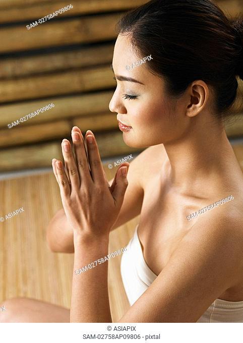 profile shot of woman meditating