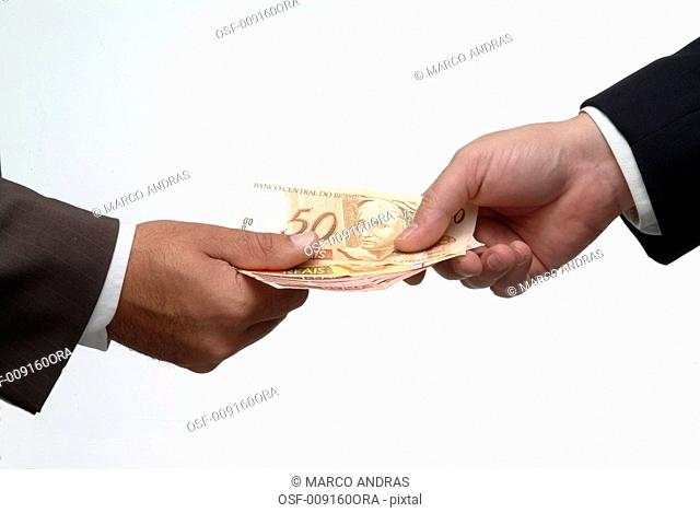 man giving money to the other