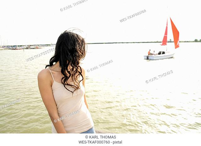 Austria, Jois, young woman at Lake Neusiedl