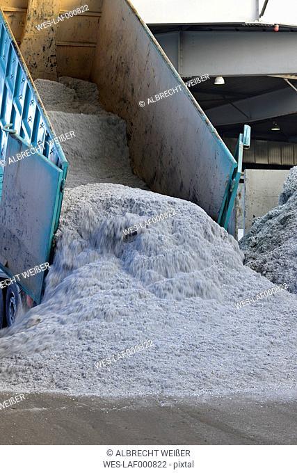Dump truck unloading aluminium chips in a scrap metal recycling plant