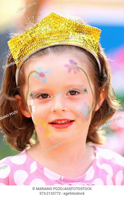 Girl with paint face in her birthday