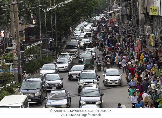 DHAKA, BANGLADESH - JUNE 12 : Traffic jam and peoples crowd seen at New Market area during the Ramadan in Dhaka , Bangladesh on June 12, 2018