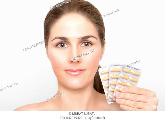 Beautiful laughing woman face and tablets in hand