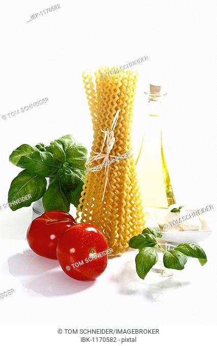 Italian specialties, pasta, tomatoes, basil, mozzarella and olive oil