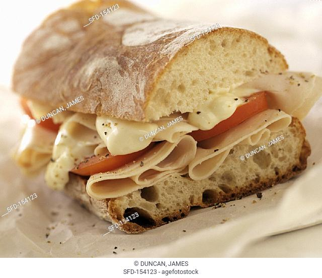 Baguette with ham, cheese and tomatoes
