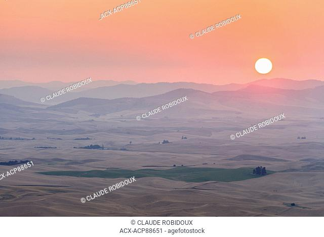 Sun rising over the rolling hills of the Palouse. Washington, USA