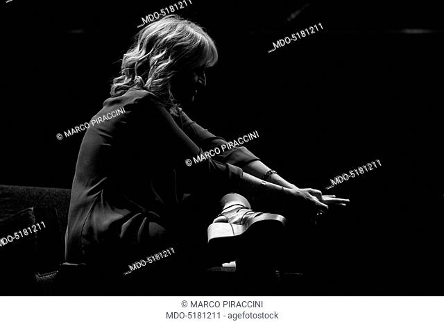Writer and comedy actress Luciana Littizzetto sitting in profile touching her fingers during the event the Women-Ñés time at the Teatro dell'Arte of the...