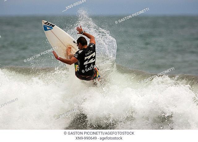 Surfer in Playa Hermosa, Jacó, Costa Rica