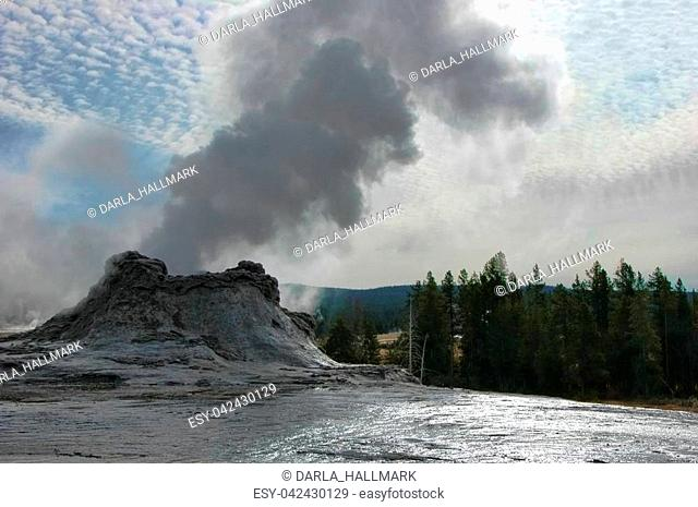 Yellowstone National Park, Castle geyser beginning to erupt, and reflecting in its own expelled waters