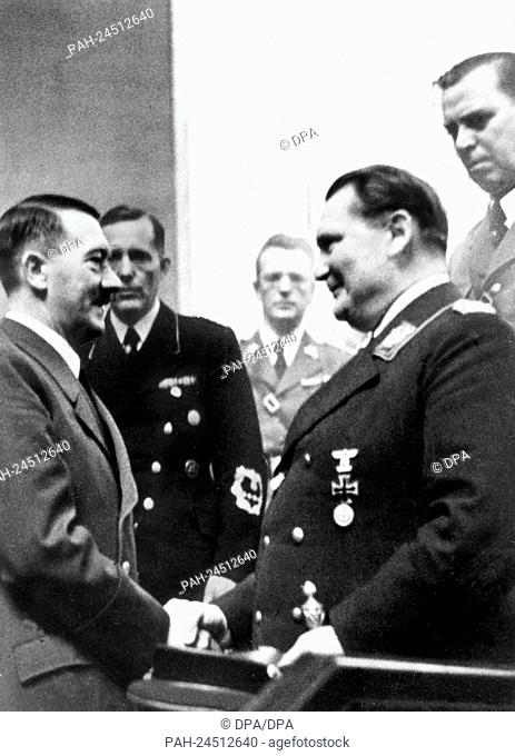Adolf Hitler (L) meets President of the Reichstag and Commander-in-Chief of the German Luftwaffe (Air Force) Hermann Göring (2nd from right)