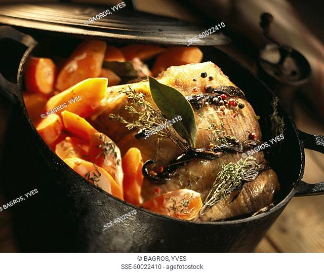 Veal and carrots cooked in a cast iron casserole dish