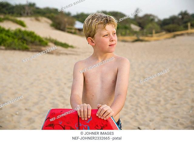 Boy on beach looking away