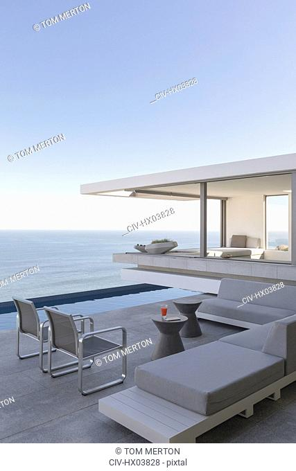 Modern, luxury home showcase exterior patio with ocean view