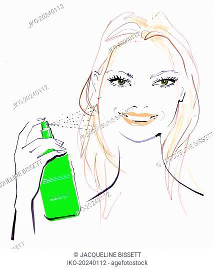 Close up of beautiful woman spraying hair