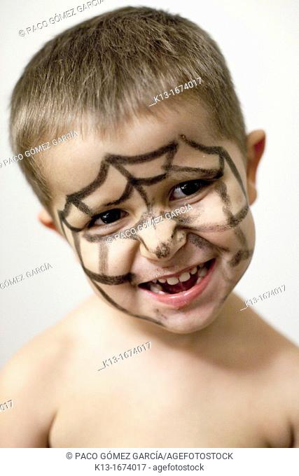 Child with painted face spiderman