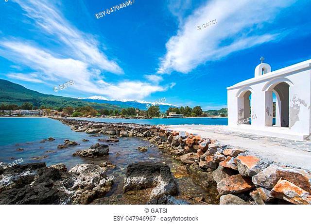 Small white church Saint Nicholas in the sea, Georgioupoli, Crete, Greece