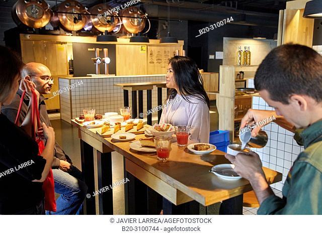 Breakfast in Cafe Tabakalera, Gastronomic tour, barista and guide with tourist couple, Donostia, San Sebastian, Gipuzkoa, Basque Country, Spain, Europe