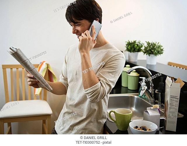 Man talking on phone in kitchen