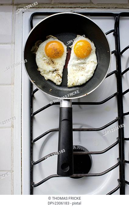 Two Sunny Side Up Fried Eggs In A Pan On An Oven;Aguascalientes Aguascalientes Mexico
