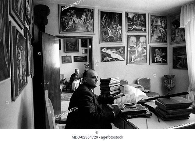 Italian professor Lando Degoli sitting at his desk. Lando Degoli took part in the TV show Lascia o raddoppia in 1955. Carpi, 1965