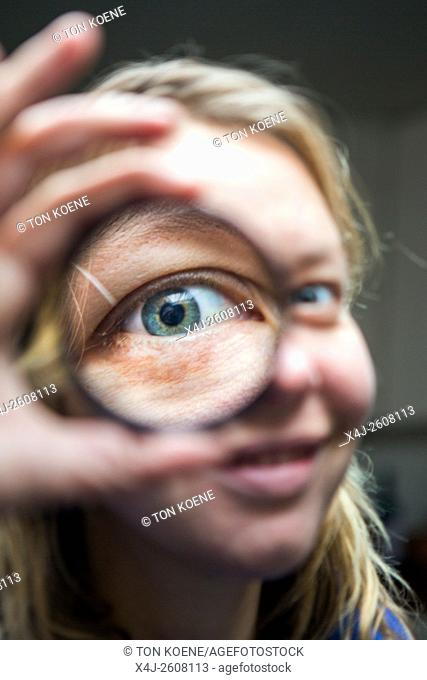 Optician is measuring eyes for reading glasses