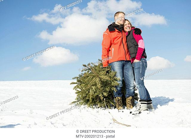 Couple standing with spruce, smiling, Bavaria, Germany