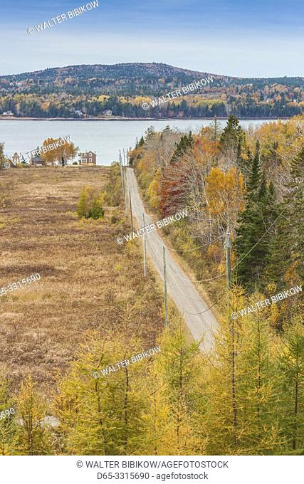 Canada, New Brunswick, Bay of Fundy, Bayside, elevated view of country road and house, autumn