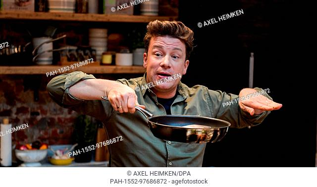 """The British chef Jamie Oliver cooks at the One Kitchen Culinary School in Hamburg, Germany, 6 December 2017. Oliver also presented his book """"""""5 Ingredients -..."""