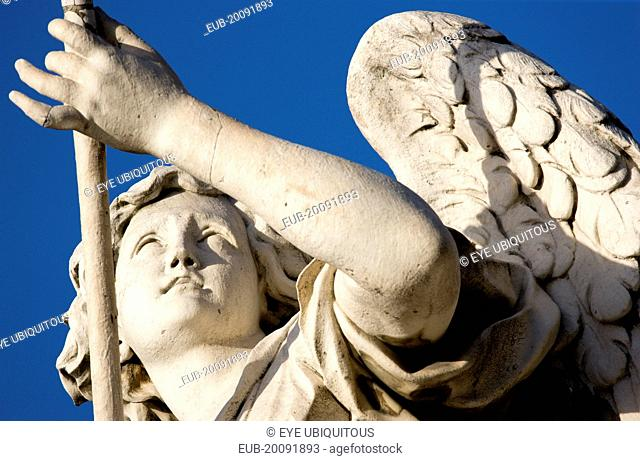Statue of a winged female angel on the Ponte Sant Angelo bridge over the River Tiber