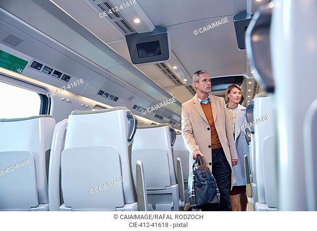 Business people boarding passenger train