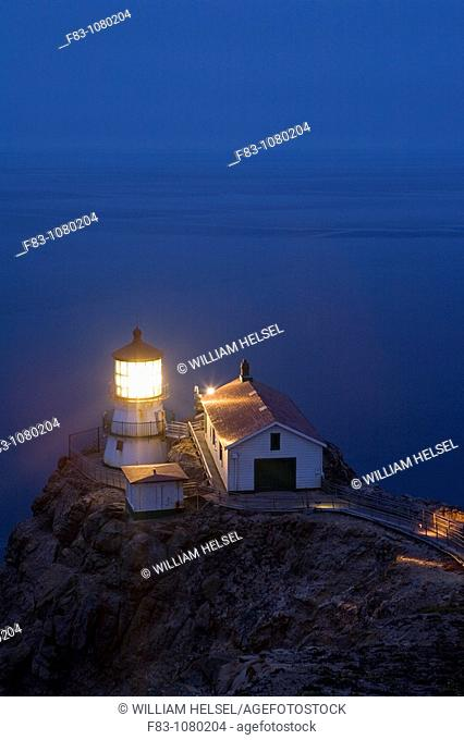 USA, California, Marin County, Point Reyes National Seashore, old lighthouse on the left, modern light on the right, perched on point of Point Reyes...