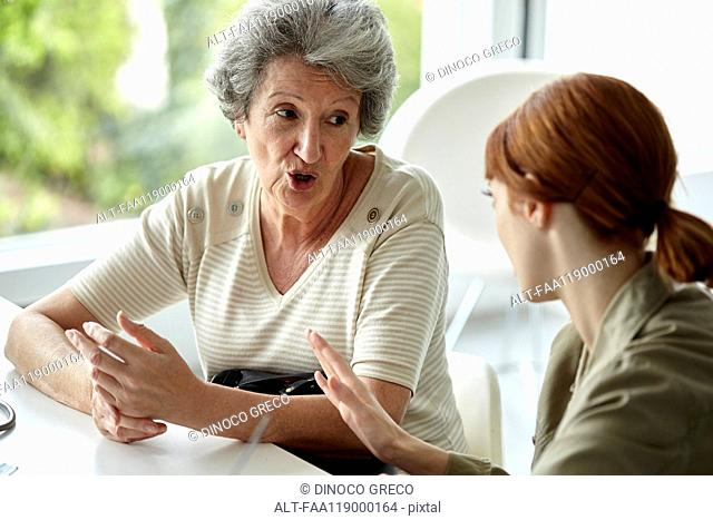 Senior patient talking with her daughter