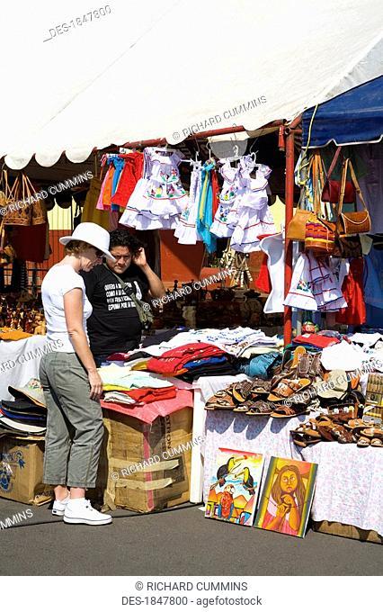 Puerto Corinto, Chinandega, Nicaragua, Central America, Shopper in outdoor craft market