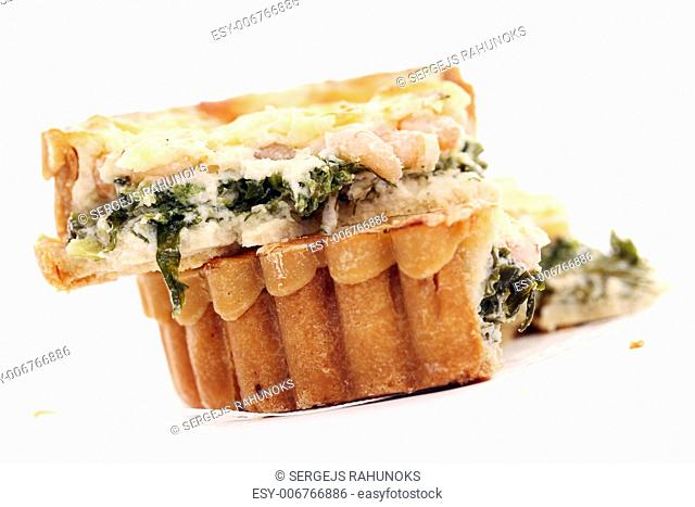 Fresh cutted tart with shrimps and green