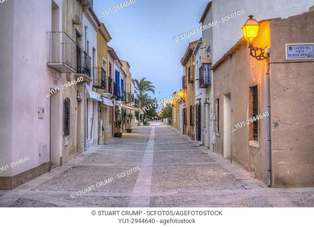 HDR image of Street lights on the Main street at dusk on the Spanish Island of Tabarca