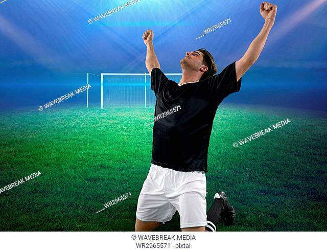 soccer player on knees celebrating a goal