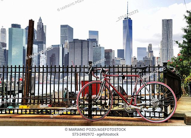 Bicycle and skyline view from Brooklynn, Manhattan, New York, USA