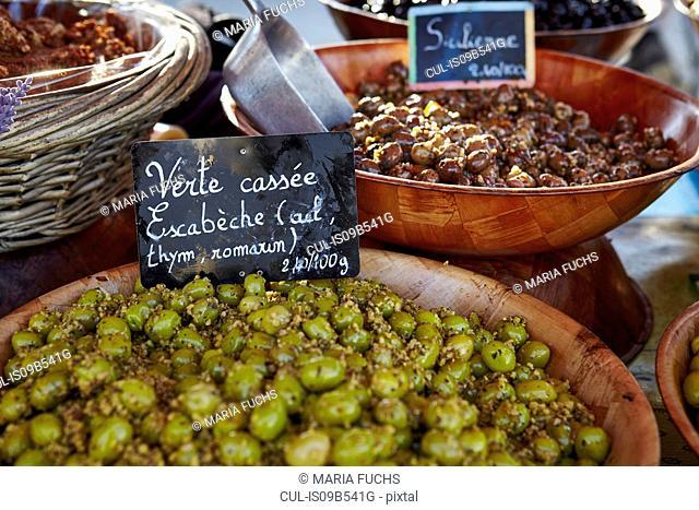 Bowls of fresh olives on market stall, St Tropez, Cote d'Azur, France