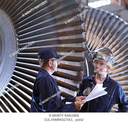 Engineers Next To Turbine