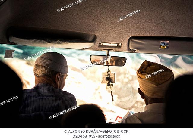 driver and passenger, Azilal, Morocco