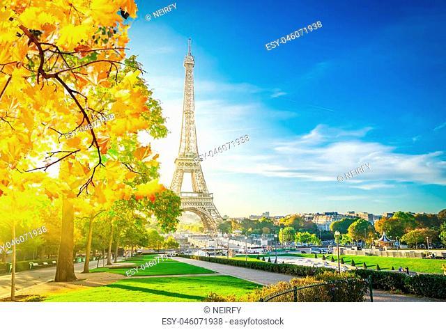 view of Eiffel Tower landmark from Trocadero at fall sunrise, Paris, France, toned
