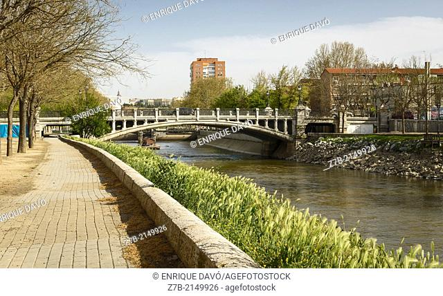 River view with perspective of Manzanares river, Madrid city, Spain