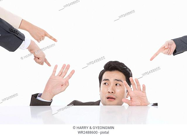 Portrait of stressful businessman and fingers pointing to him