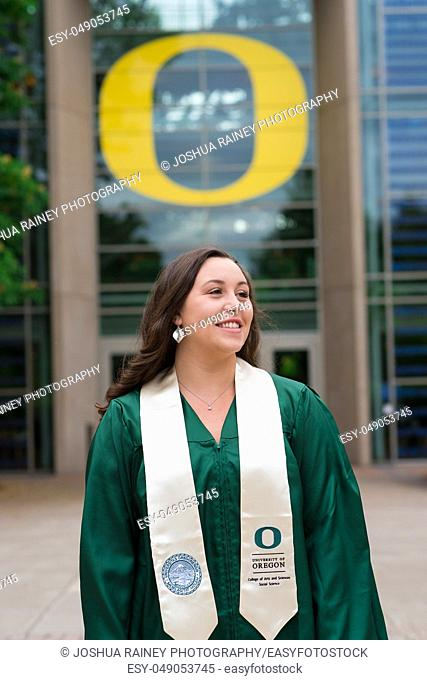 Eugene, OR - May 19, 2019: University of Oregon graduate Lacie Brown celebrates her graduation in cap and gown on campus in Eugene